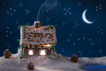 Smoke poured out of the gingerbread home at night photo