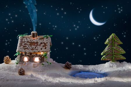 Gingerbread home with blue smoke and moon with stars photo