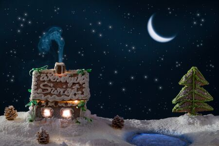 Gingerbread cottage in at the lake in winter photo