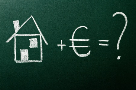 Concept of home buying on green blackboard photo
