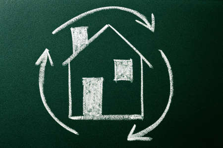 Concept of Home recycling on green blackboard photo