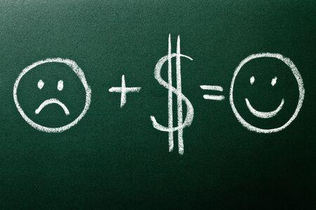 Money makes you smile on green blackboard
