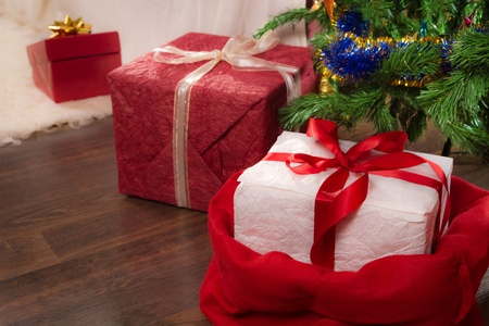 Closeup red present under christmas tree Stock Photo - 11429599
