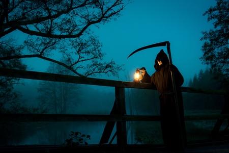 Moonlight lanterns: Man looks like death with scythe on old bridge