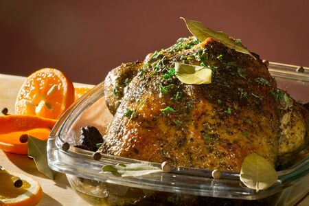dish disk: Roasted chicken in casserole dish with herbs Stock Photo