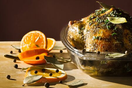 Roasted chicken with orange fruit and herbs photo