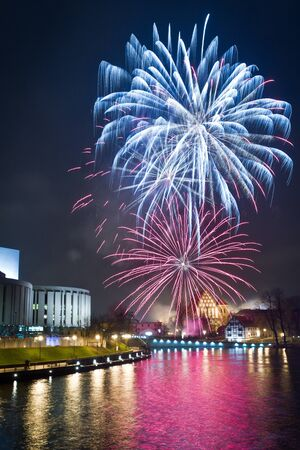 Fireworks over the river in the city