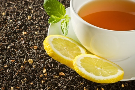 Hot cup of tea with lemon on grain background Stock Photo - 12067305