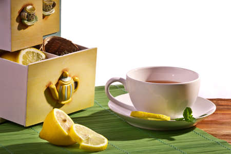 Cup of tea and Cupboard with lemon Stock Photo - 12067298