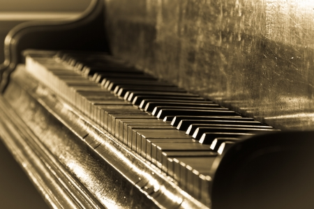 Antique piano and sepia toned photo