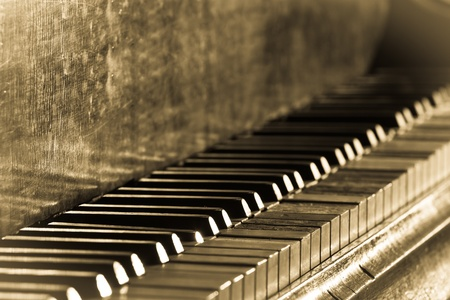 Old vintage piano in sepia toned
