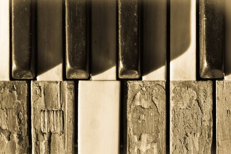 Closeup old piano keys in sepia toned photo