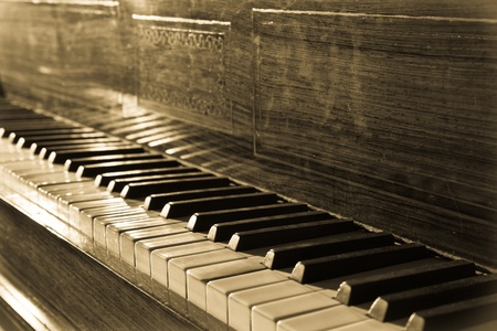 Vintage piano in old fashioned toned photo