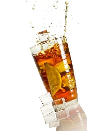 ice lemon tea: Big splash in ice lemon tea Stock Photo