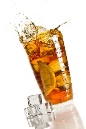 Ice splash in a glass with lemon tea