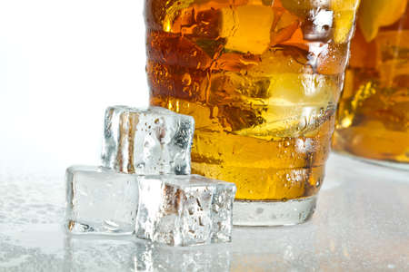 dewdrop: Closeup ice tea with dewdrop on cubes Stock Photo