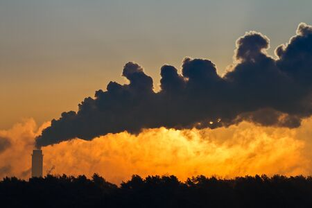 Thermal power station and Smoke at Sunset photo
