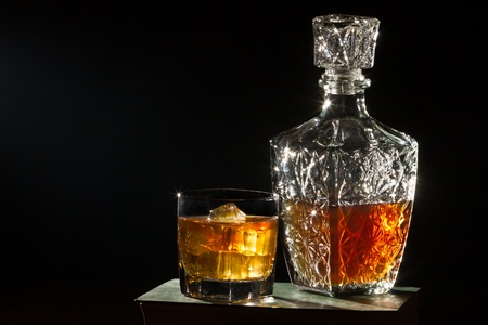 Whisky with glass and  carafer on book photo