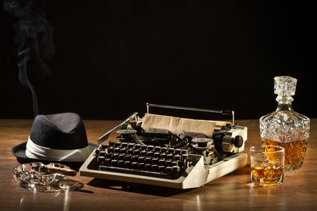 mistic: Retro-Styled old typewriter, cigar, hat and whisky with carafe