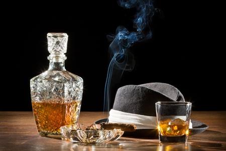 cigar smoke: Retro hat, smoking cigar and whisky on rock
