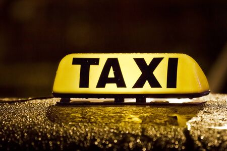 Taxi sign in rainy day