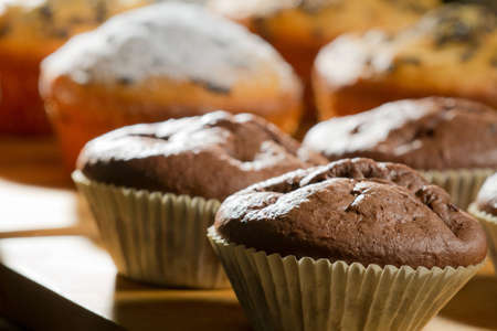 Various muffin on wooden board photo