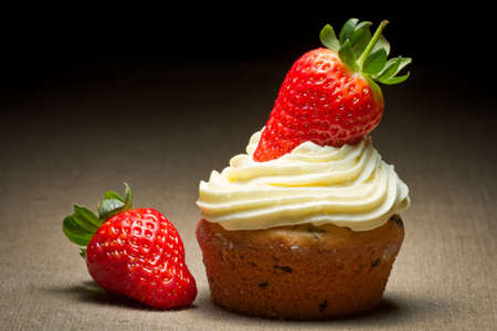 Big muffin with strawberrys and sweet cream photo