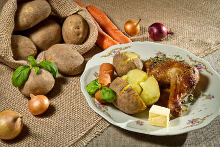 Roasted chicken leg serve with jacket potatoes and vegetables photo