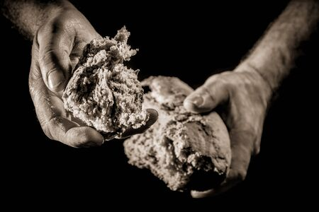 A helping hand with piece of bread photo