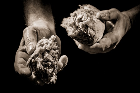 Human Hand giving a piece of bread Stock Photo - 12583382