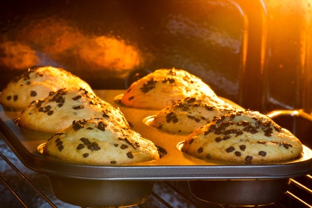 oven tray: Baking tray with muffins in hot oven