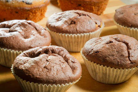 Closeup various muffin on wooden board photo