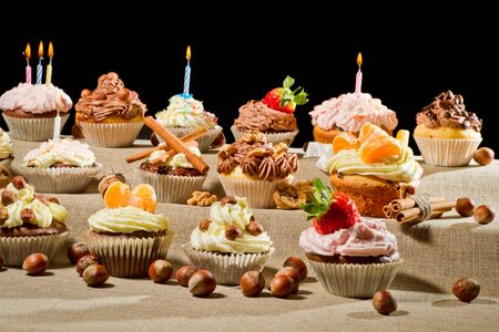 Birthday muffins with cream and nuts photo