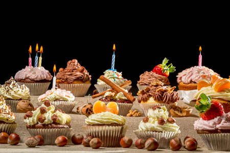 Closeup birthday muffins with cream and nuts Stock Photo - 12850535
