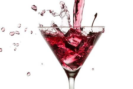 gin: Red drink poured with a splash of ice cube on white background Stock Photo