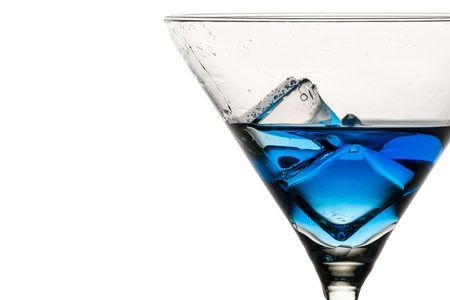 Closeup ice cubes with drops in martini glass photo
