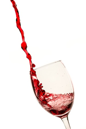 Splash of red wine in the glass on white background Stock Photo - 12853268