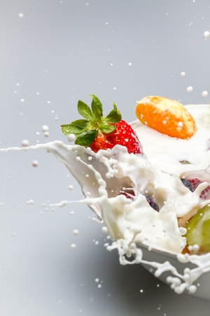 Breakfast splash with milk and fresh fruits Stock Photo - 13138952