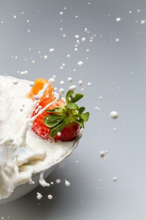 healty: Milk drops and fresh fruit Stock Photo