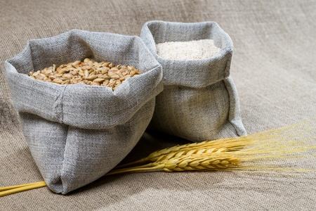 threshing: Closep canvas sack of seed
