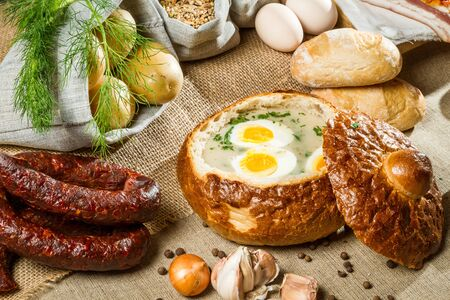 Sour soup served in bread with egg on Easter photo