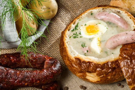 Closeup hot soup served in bread on Easter Stock Photo - 13139143