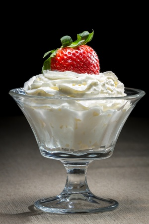 ice cream glass: Starwberry with whipped Cream in glass bowl Stock Photo