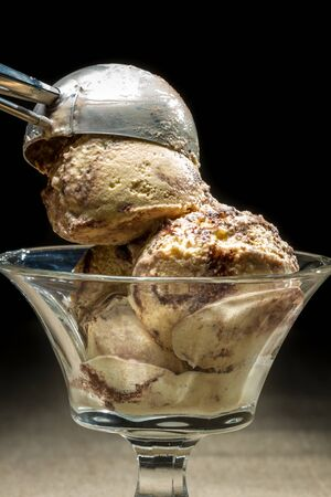 ice cream scoop: Ice cream with metallic spoon