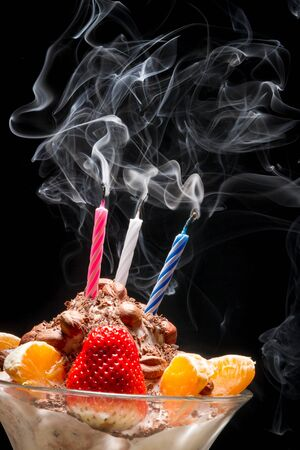 Blown off candle on birthday ice cream photo