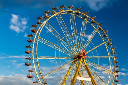 Amusement park with blue sky and clouds photo