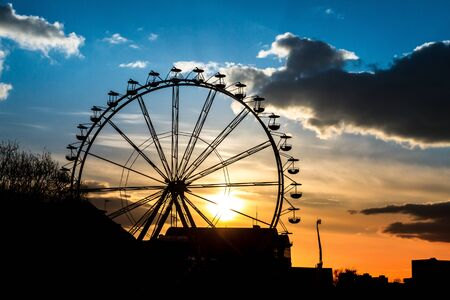 Sunset in amusement park at summer photo