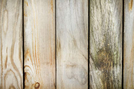 Old fence made ​​of weathered boards photo