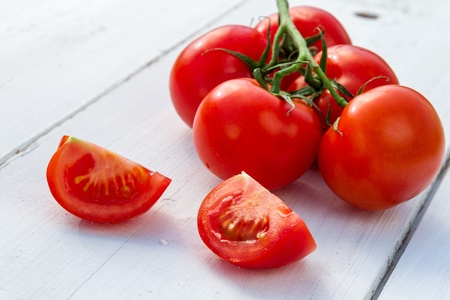 Wet fresh tomatoes as an ingredient for a healthy salad photo