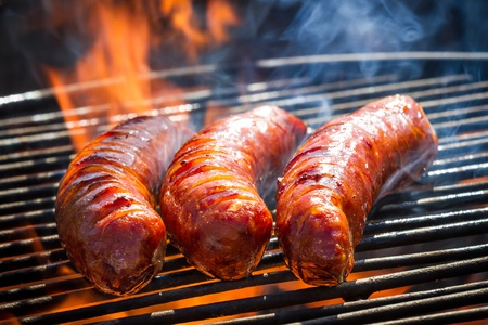 BBQ with fiery sausages on the grill Stock Photo - 13514512